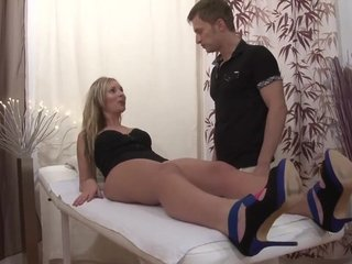 Spicy blonde gets double penetrated after oily massage